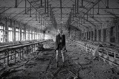 Beautiful, young girl post apocalypse girl stand in abandoned factory Stock Photography