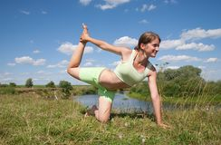 Beautiful young girl practicing yoga Royalty Free Stock Images