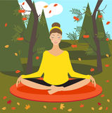 Beautiful young girl practicing yoga in the autumn park Royalty Free Stock Images