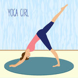 Beautiful young girl practicing yoga in the gym Royalty Free Stock Images