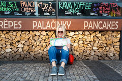 Beautiful young girl in Prague looks at the city map. Stock Images