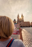 Beautiful young girl in Prague looks at the city map. Royalty Free Stock Images