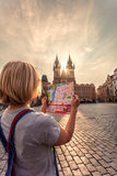 Beautiful young girl in Prague looks at the city map. Royalty Free Stock Image