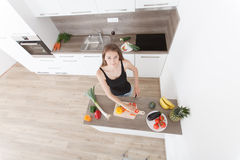 Beautiful young girl preparing a healthy dinner Stock Images