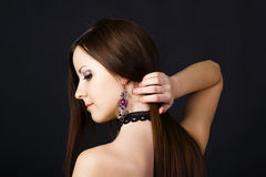 Beautiful young girl in profile with long straight hair Royalty Free Stock Image