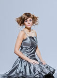 Beautiful young girl with prom dress sitting Stock Photos
