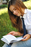 Beautiful young girl is reading a book Royalty Free Stock Photography