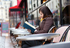 Beautiful young girl reading a book Stock Photo