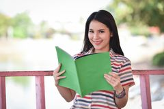 Beautiful young girl reading book Royalty Free Stock Photography