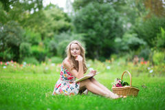 Beautiful young girl reading a book Royalty Free Stock Photo