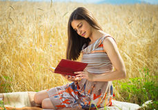 Beautiful young girl reading book Stock Photo