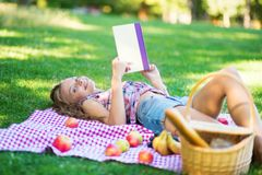 Beautiful young girl reading a book Stock Photography