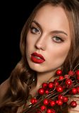 Beautiful young girl with red berries Stock Photo