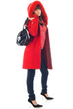 The beautiful Young girl in a red coat Royalty Free Stock Photos