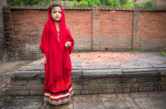 Beautiful young girl in a red dress ahead of a ceremony. stock image