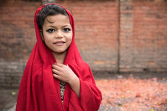 Beautiful young girl in a red dress ahead of a ceremony. stock photo