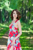 Beautiful young girl in red dress Stock Photography