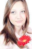 Beautiful young girl with red flower isolated Royalty Free Stock Images
