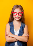 Beautiful young girl with red glasses royalty free stock image
