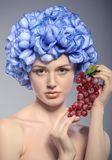 Beautiful young girl with red grapes Stock Photos