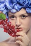 Beautiful young girl with red grapes Stock Images