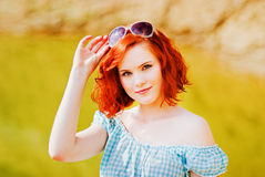 Beautiful young girl with red hair Stock Photos