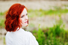 Beautiful young girl with red hair Stock Images