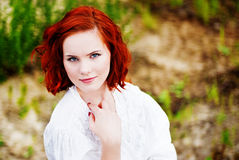 Beautiful young girl with red hair. Picture of a Beautiful young girl with red hair Royalty Free Stock Images
