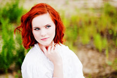 Beautiful young girl with red hair. Picture of a Beautiful young girl with red hair Stock Image