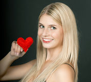 Beautiful young girl with red heart Royalty Free Stock Photo