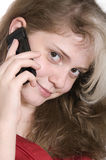 Beautiful young girl in red with a mobile phone Royalty Free Stock Photography