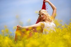 Beautiful young girl with red scarf in field Stock Photos