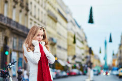 Beautiful young girl in red scarf on a Parisian street Royalty Free Stock Photography