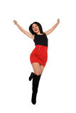 Beautiful young girl with red skirt in the air Stock Image