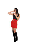 Beautiful young girl with red skirt in the air Royalty Free Stock Photo
