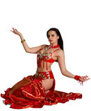 Beautiful young girl in a red suit oriental dance Stock Photos