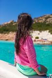 Beautiful young girl relaxing on the boat in open Stock Photos