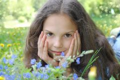 Beautiful young girl relaxing in the grass Royalty Free Stock Photography
