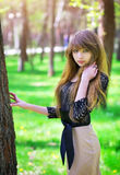 Beautiful young girl relaxing in a green forest Royalty Free Stock Photos