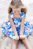 Beautiful young girl relaxing near the sea Royalty Free Stock Photo
