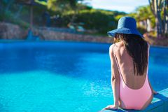 Beautiful young girl relaxing near the swimming Royalty Free Stock Photo