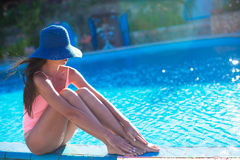Beautiful young girl relaxing near the swimming Stock Photo