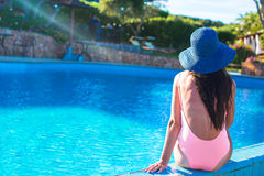 Beautiful young girl relaxing near the swimming Royalty Free Stock Image
