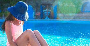 Beautiful young girl relaxing near the swimming Stock Image