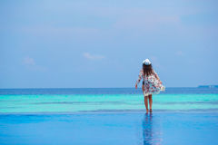 Beautiful young girl relaxing near the swimming Royalty Free Stock Images