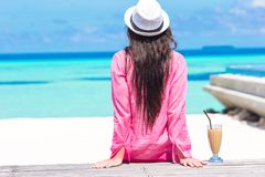 Beautiful young girl relaxing near the swimming Royalty Free Stock Photography