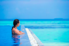 Beautiful young girl relaxing in outdoor swimming Stock Photography