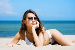 Beautiful young girl relaxing on a summer beach Stock Photo