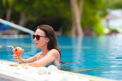 Beautiful young girl relaxing in the swimming pool Royalty Free Stock Photography