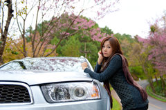 Beautiful young girl resting at side of her car at Royalty Free Stock Images